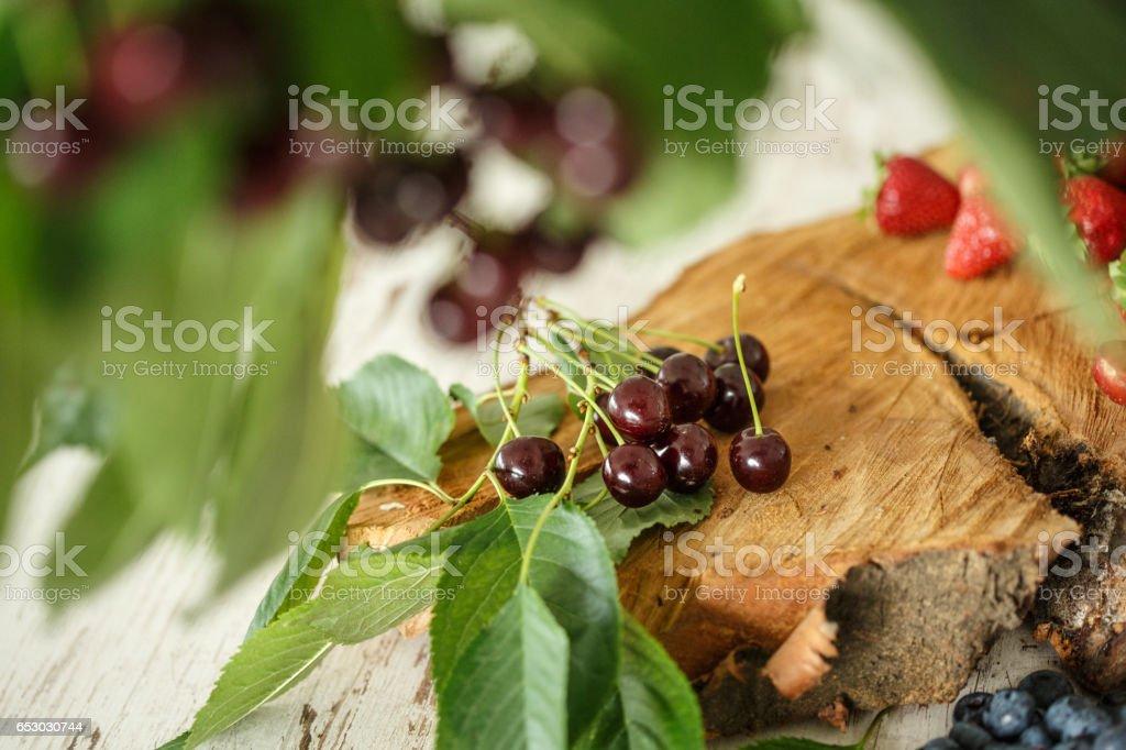 Strawberries, blueberries and cherries stock photo