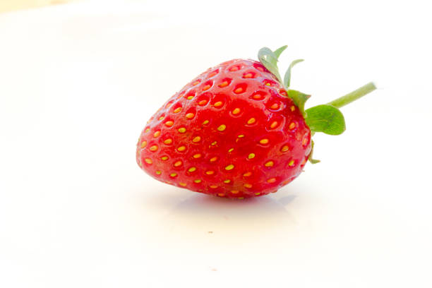 strawberries close up on white background strawberries close up on white background addle stock pictures, royalty-free photos & images