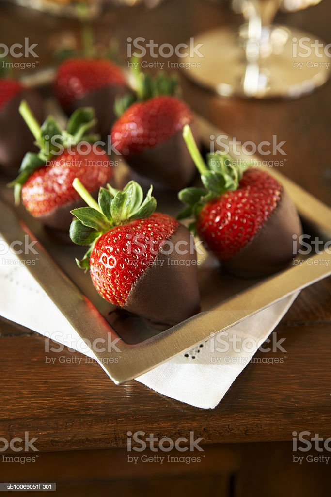 Strawberries dipped in chocolate on tray, elevated view, close-up royalty-free 스톡 사진