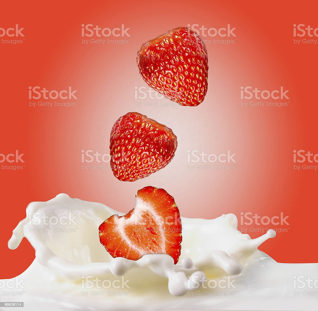 strawberries fallng in milk royalty-free stock photo