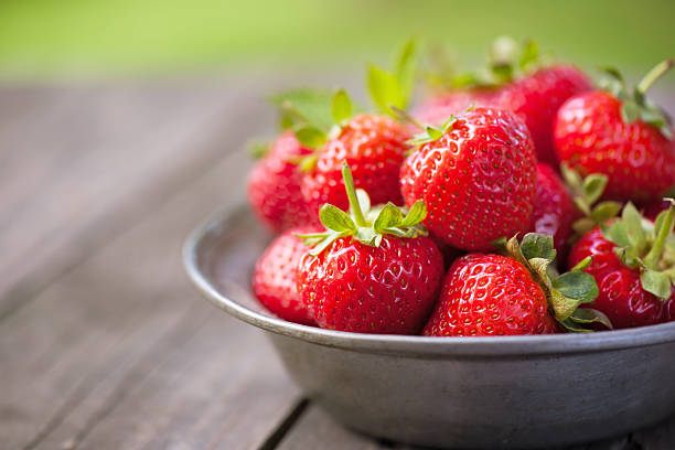 Strawberries in a bowl with copy space stock photo