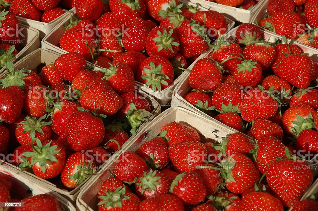 Strawberries in baskets royalty-free stock photo