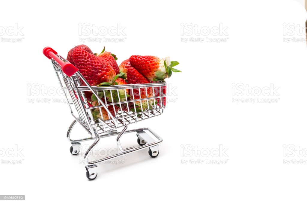 Strawberries in shopping cart stock photo