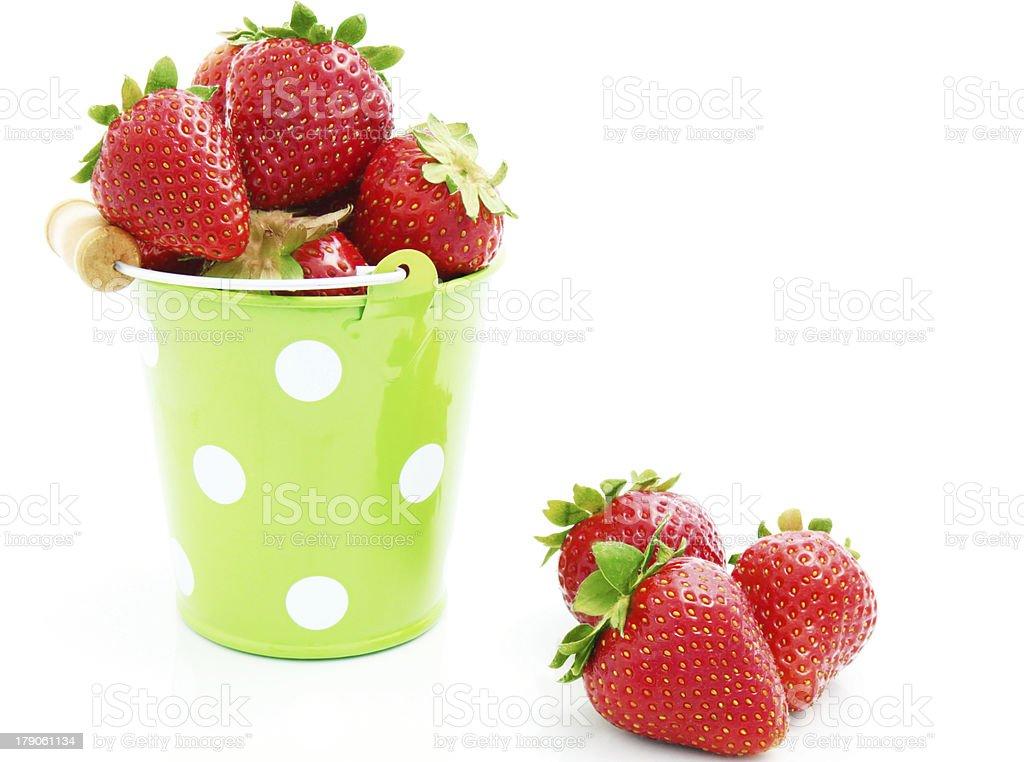 strawberries in the bucket stock photo