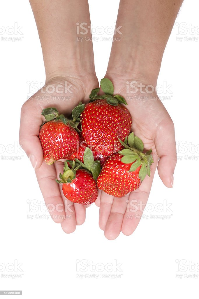 Strawberries in the hand royalty-free stock photo