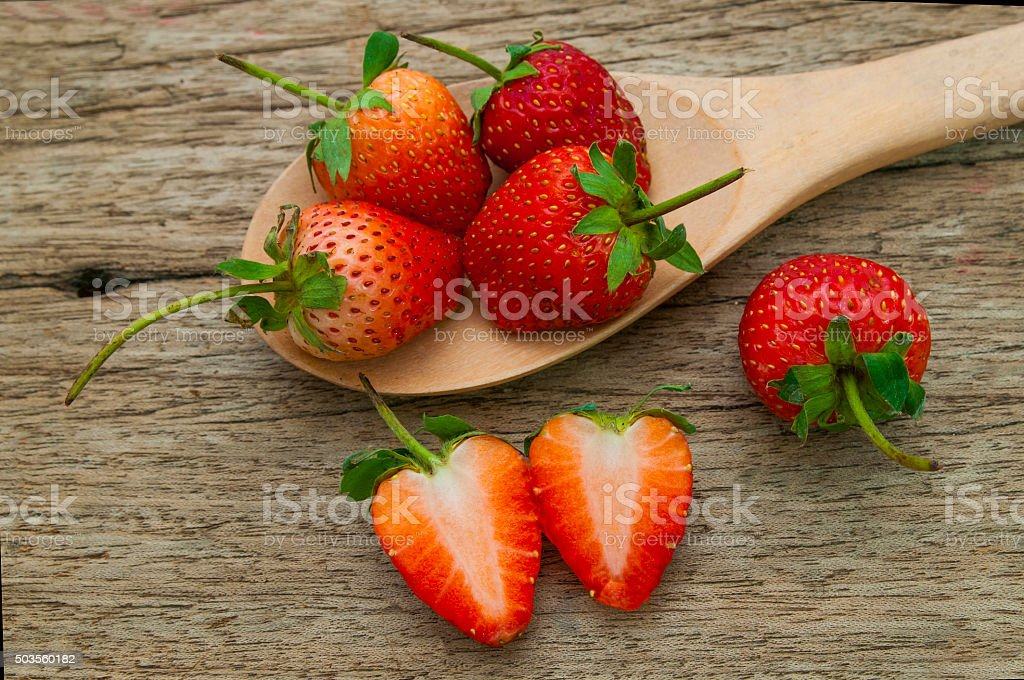 Strawberries , in the spoon on the table,Thailand stock photo