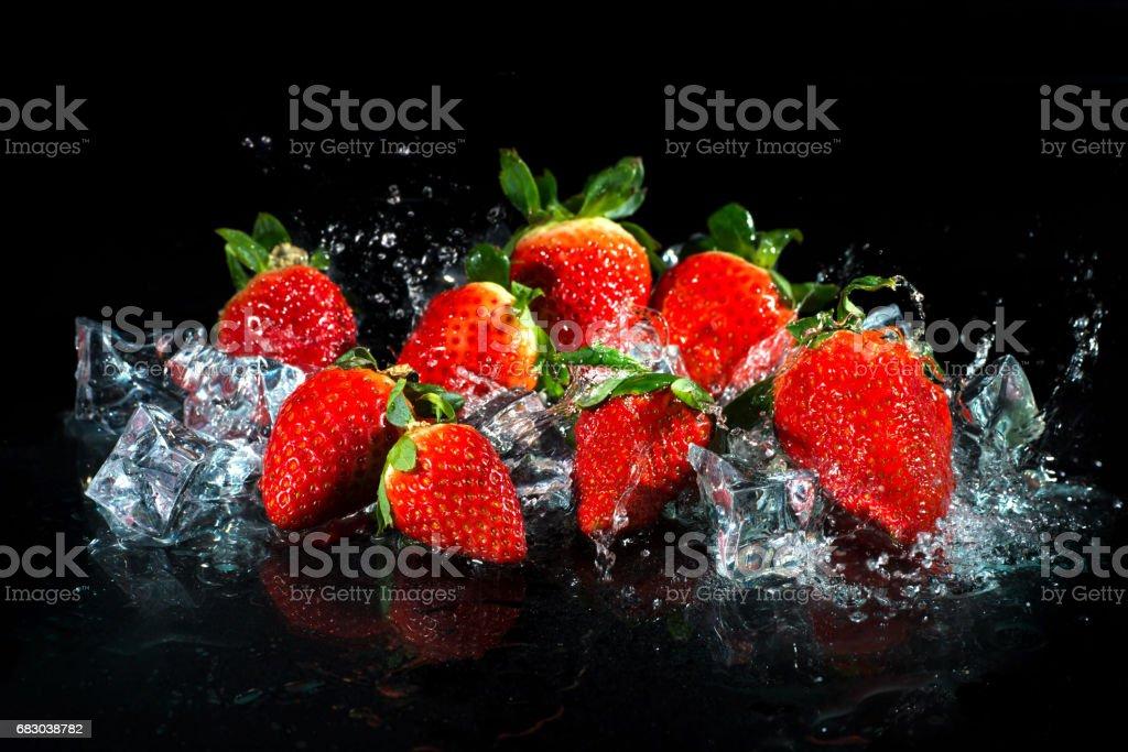 Strawberries in water splash foto de stock royalty-free