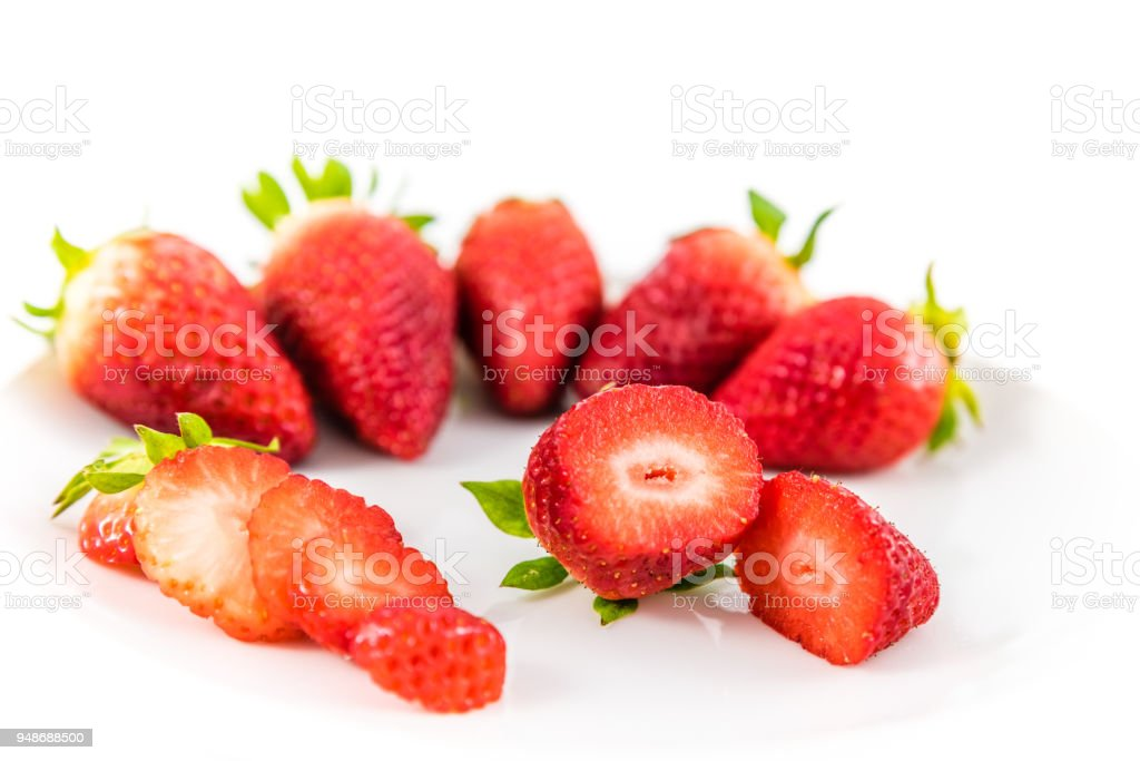 strawberries in white porcelain dish with white background stock photo