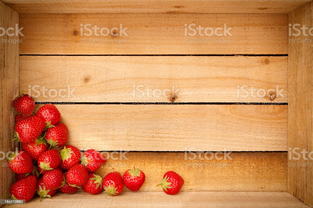 Strawberries inside a wooden crate royalty-free stock photo