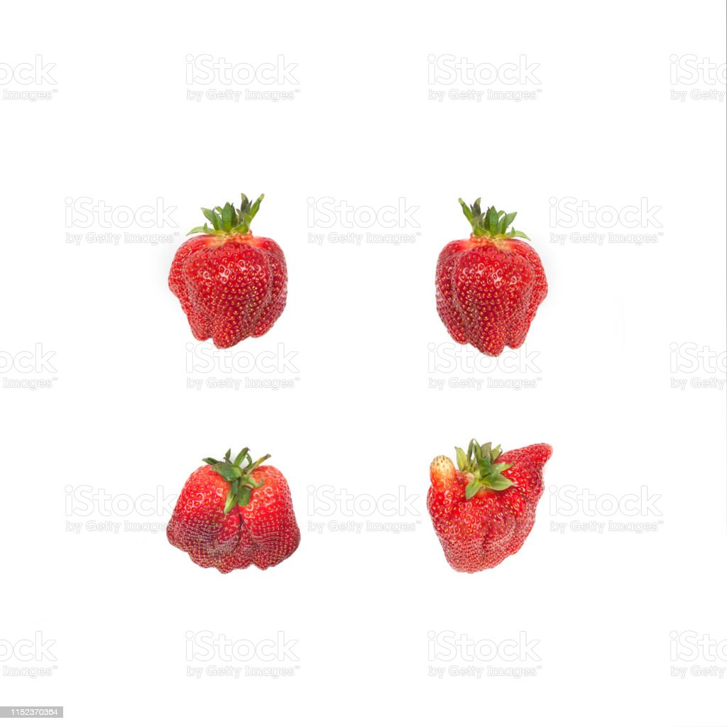 Strawberries isolated on white.Ugliness. Pattern with red organic strawberries isolated on white. Natural ugly strawberries.Flat lay.Ugly food. Agriculture Stock Photo