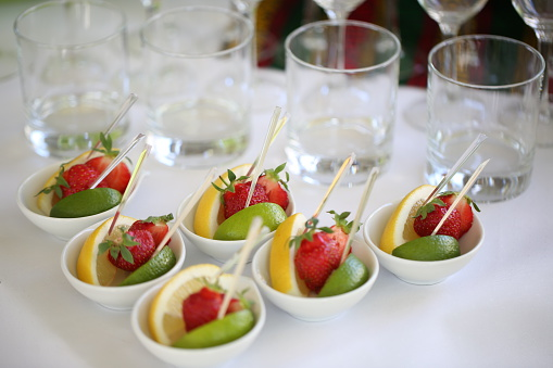 Strawberries, Lemon and Lime Served in Take Out Trays on