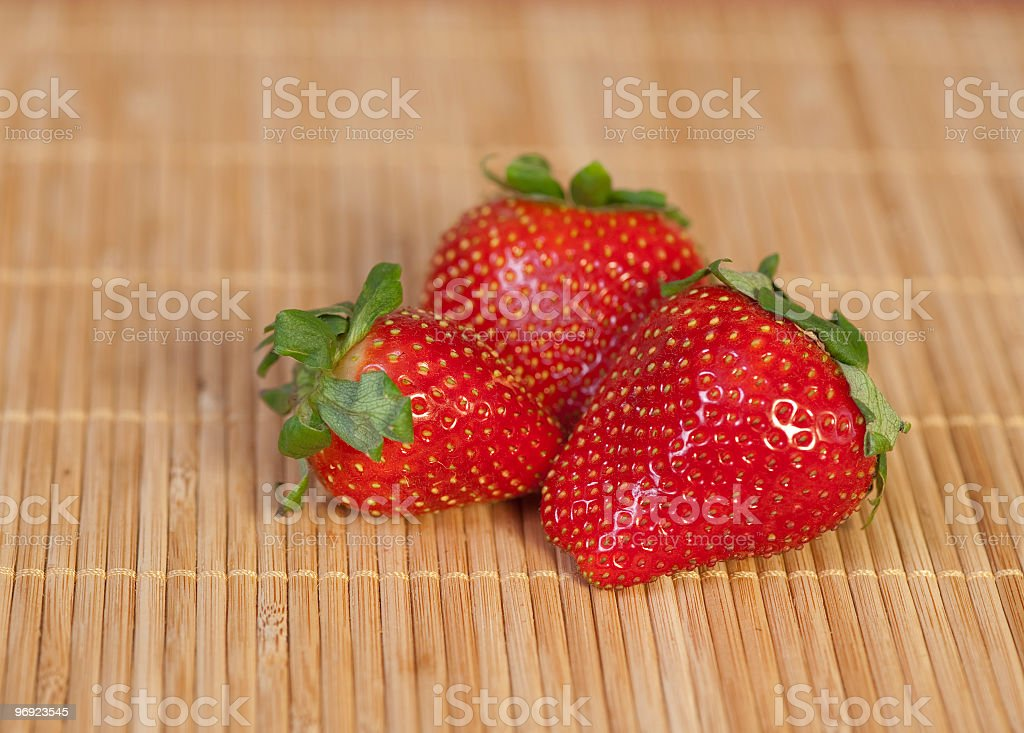 Strawberries on a place mat royalty-free stock photo