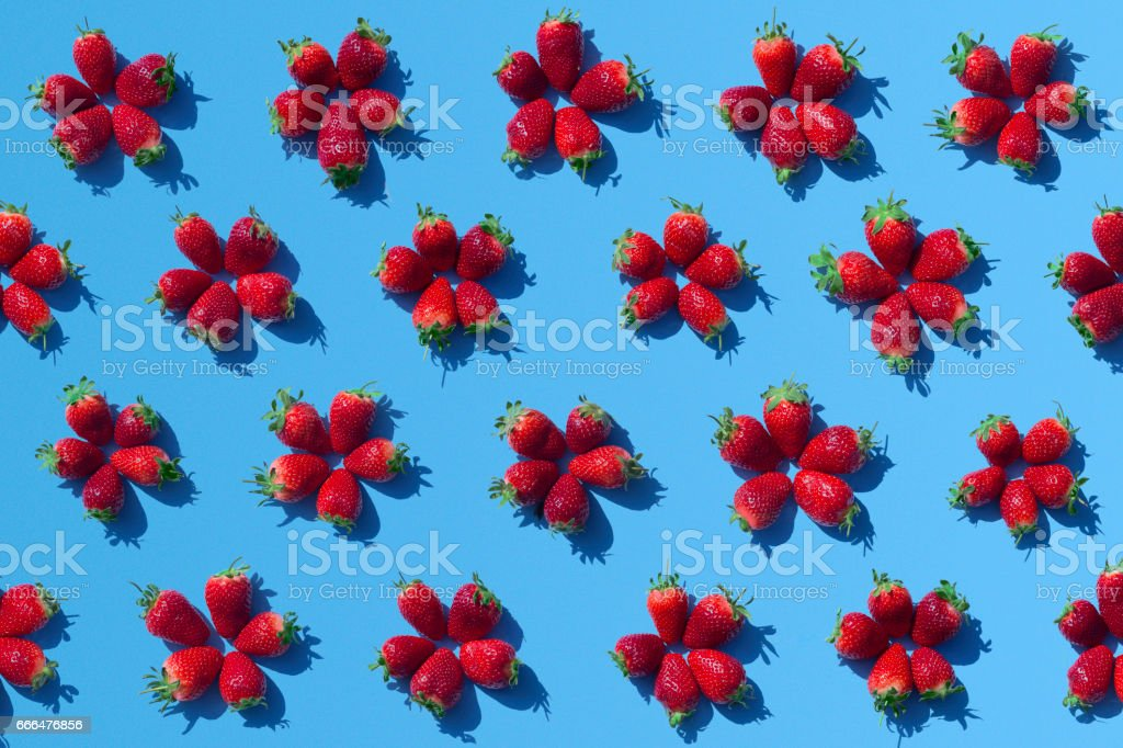 Strawberries on blue background stock photo