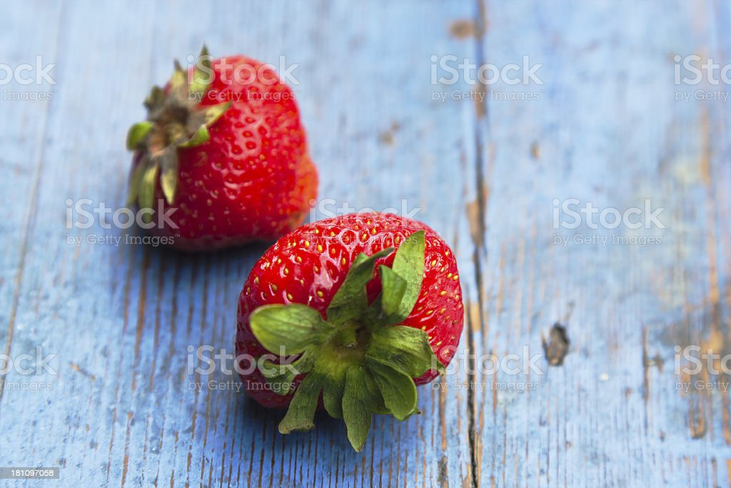 Strawberries on blue painted wooden  bench. royalty-free stock photo