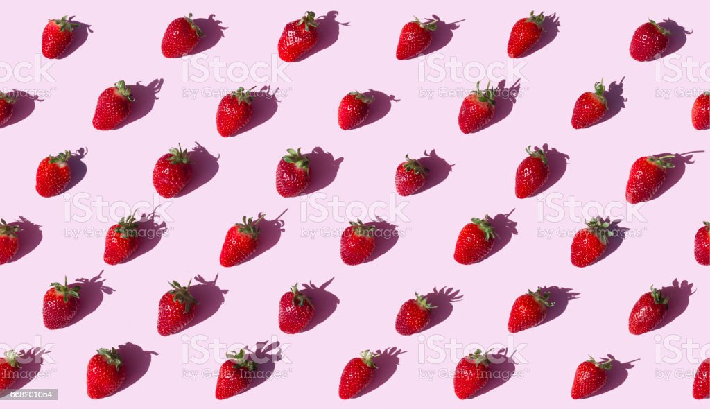 Strawberries on pink background seamless stock photo