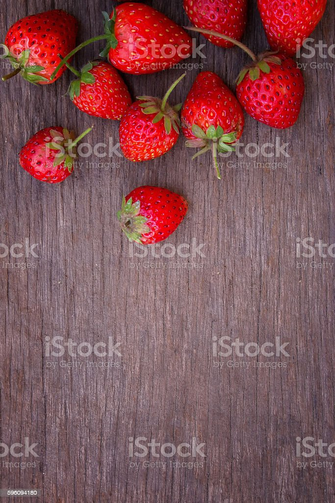 Strawberries on wood background royalty-free stock photo