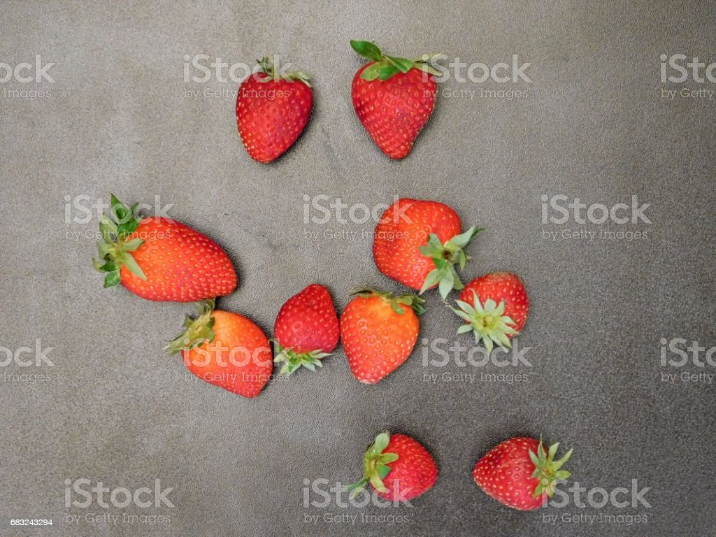 Strawberries on wooden background royalty-free stock photo