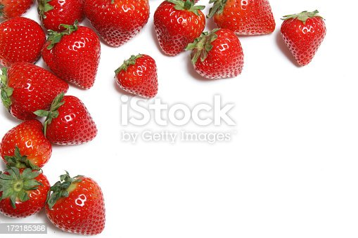 A perfect patch of fresh organic strawberries in a border arrangement.