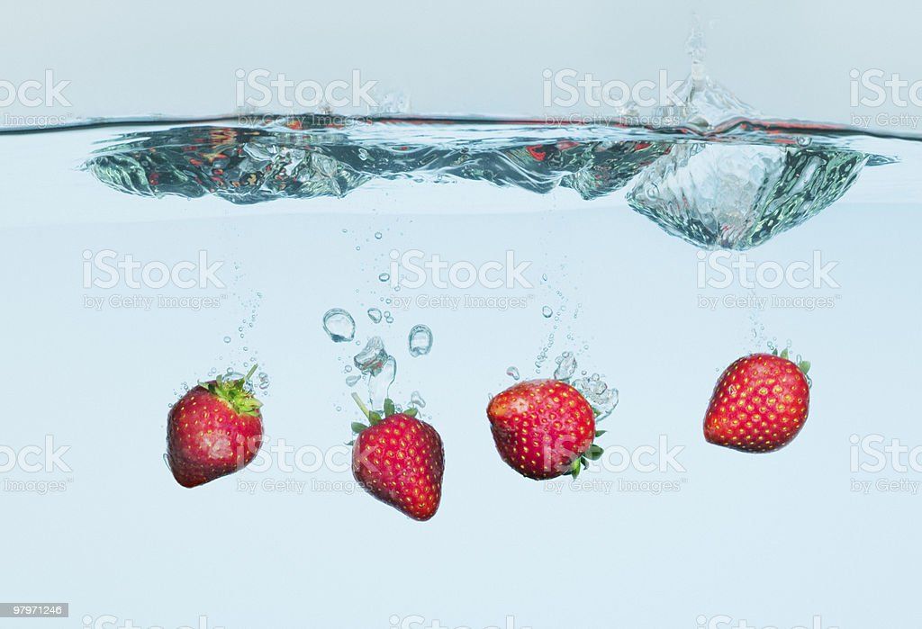 Strawberries splashing in water royalty-free stock photo