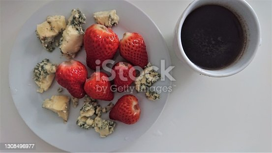 British Stilton blue cheese, served with strawberries, and coffee. Nice afternoon snack.
