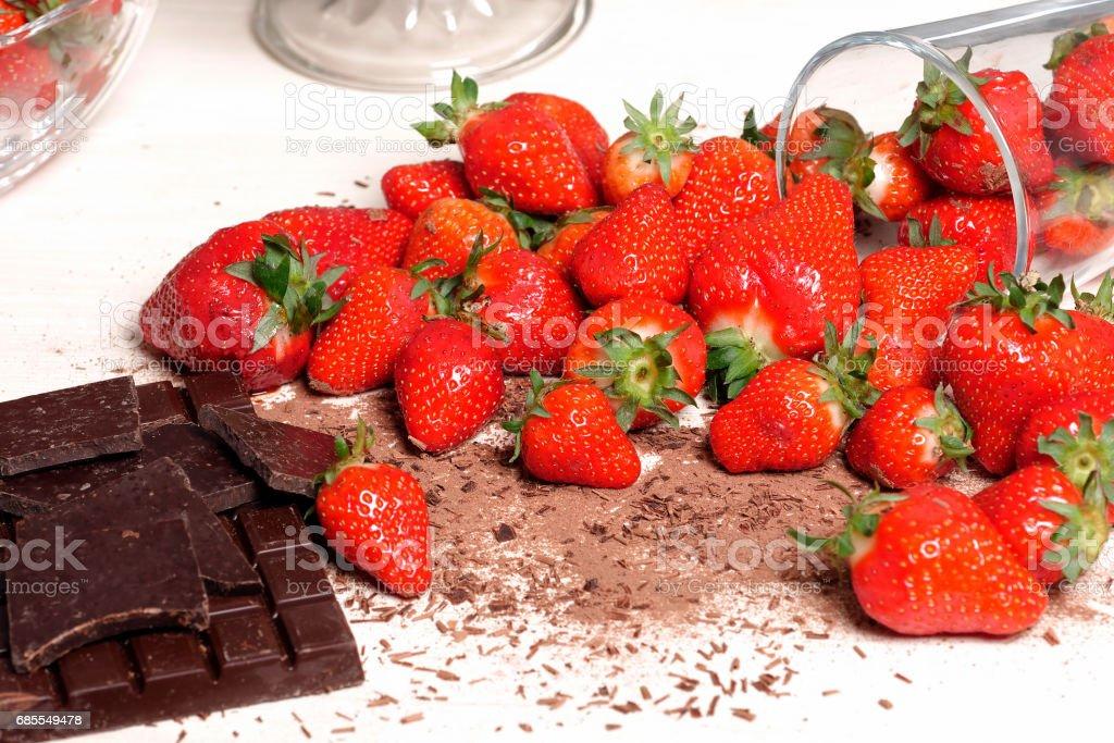 Strawberries with a dark chocolate bar 免版稅 stock photo