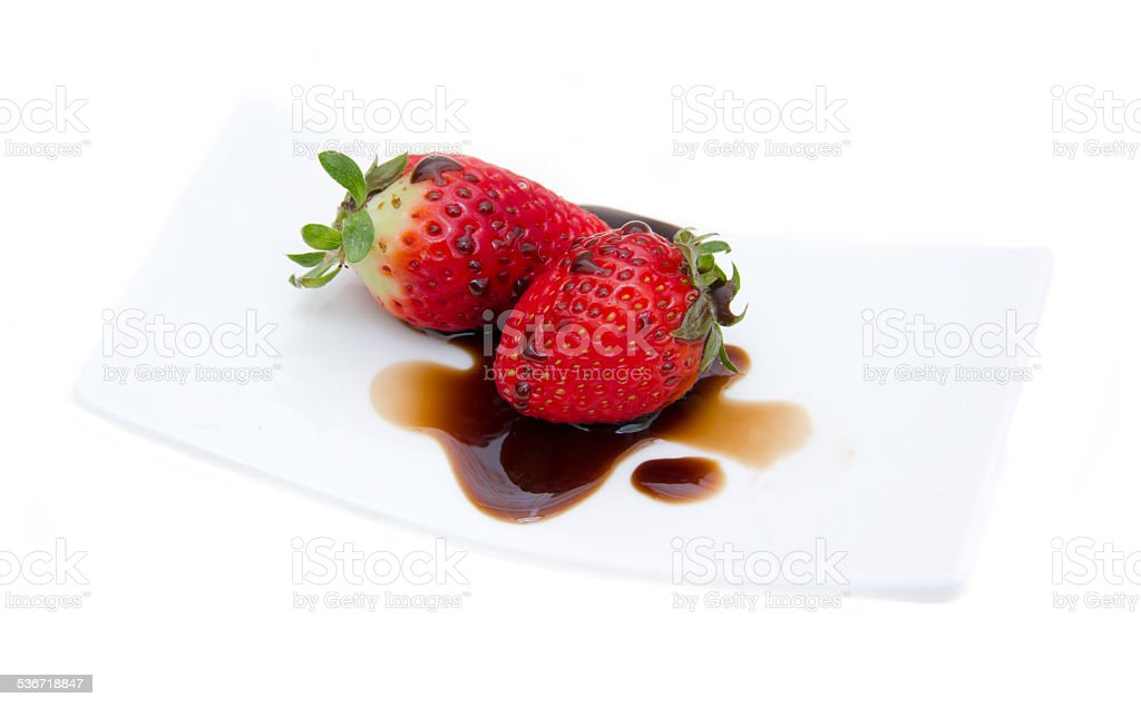 Strawberries with balsamic vinegar stock photo