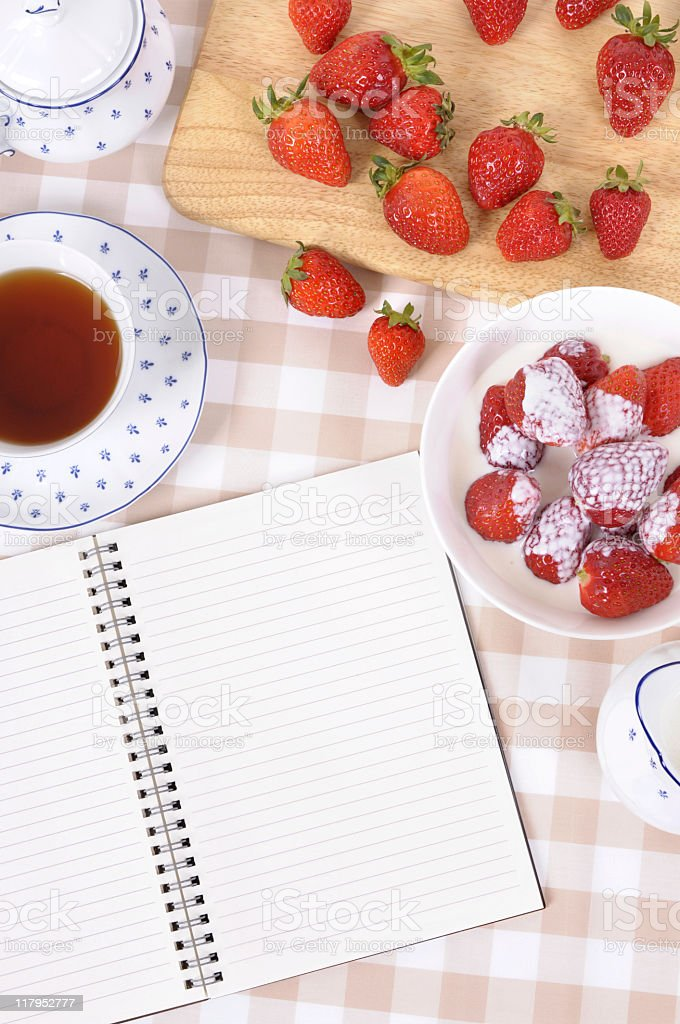 Strawberries with blank recipe book and check tablecloth royalty-free stock photo