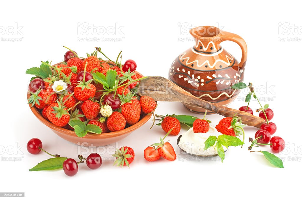 Strawberries with cream and ripe cherry. stock photo