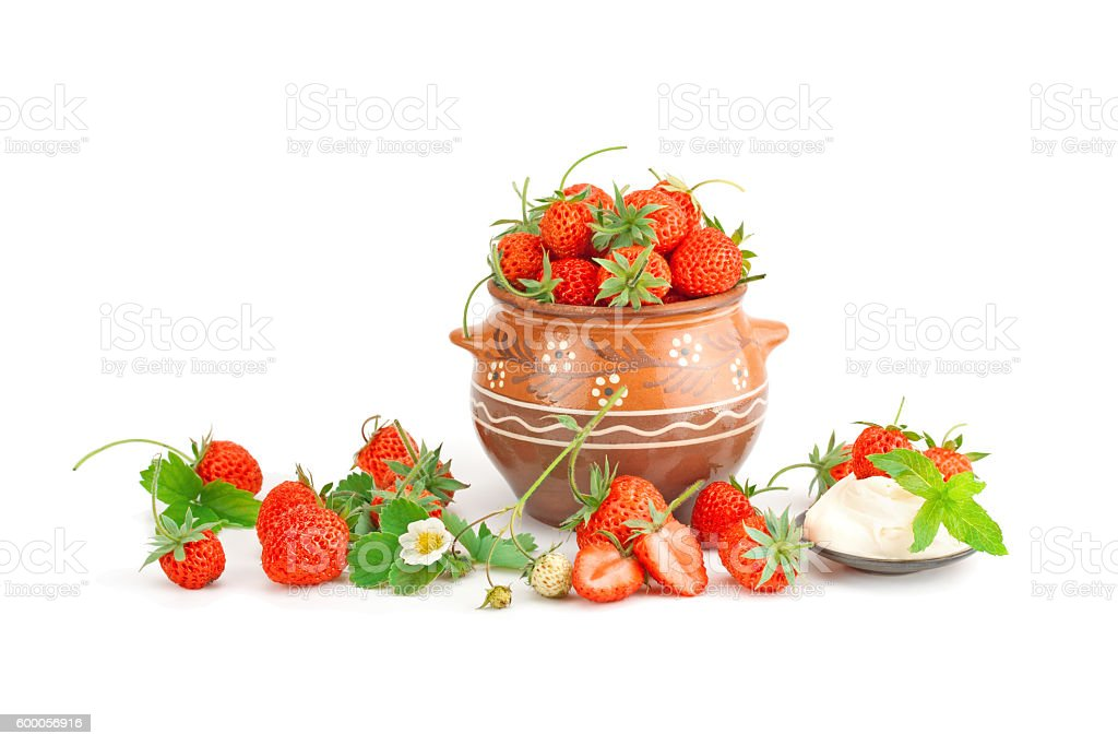 Strawberries with cream . stock photo