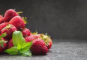 Strawberries on dark background