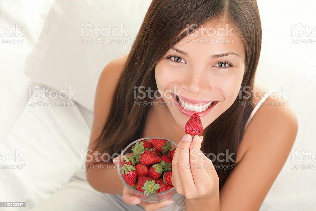 Strawberries woman stock photo