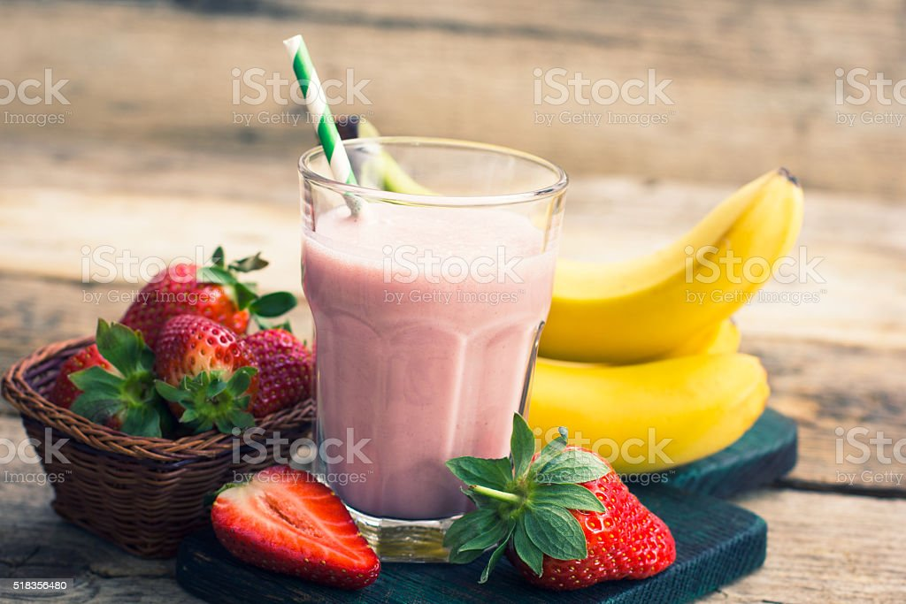 Strawberry and banana smoothie in the glass stock photo
