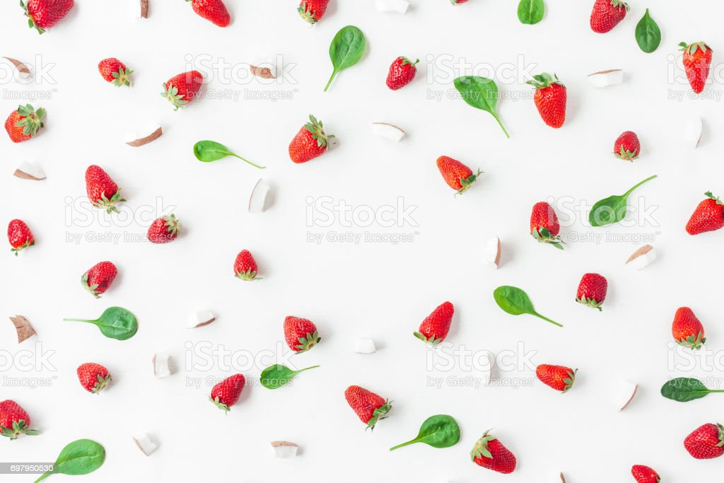 Strawberry and coconut on white background. Flat lay, top view
