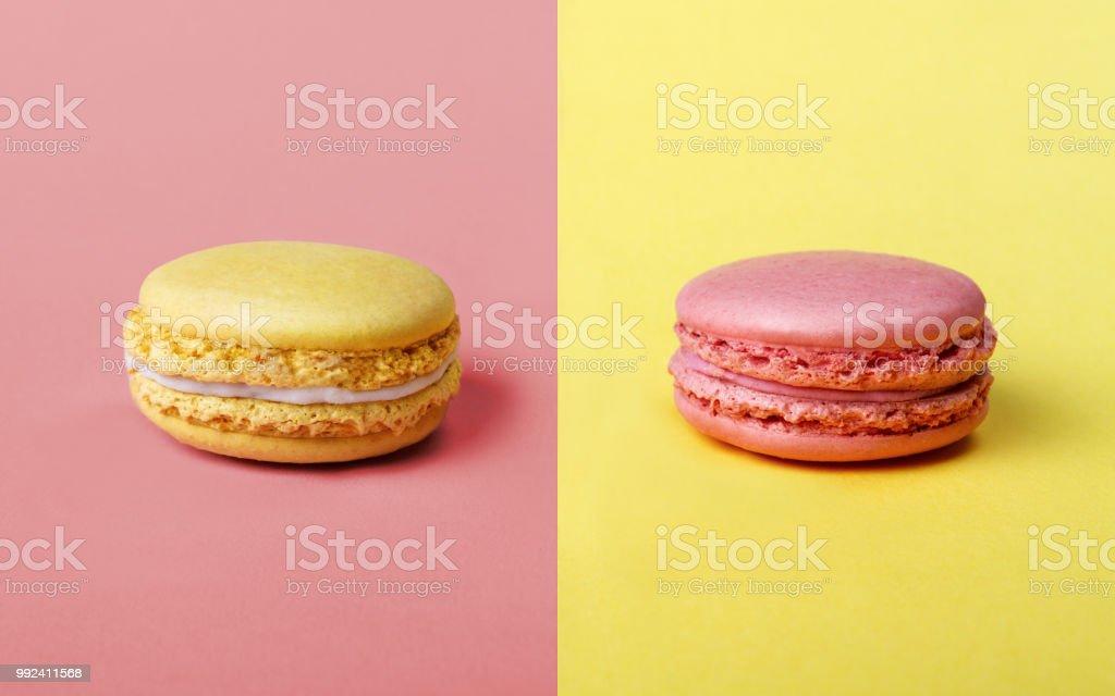 Jordgubbar och citronsmak franska Macarons - Royaltyfri Beskrivande färg Bildbanksbilder