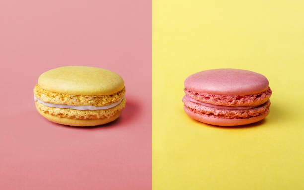 strawberry and lemon flavor french macarons - symmetry stock photos and pictures
