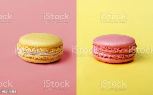 Pink and yellow french Macarons opposites attract position