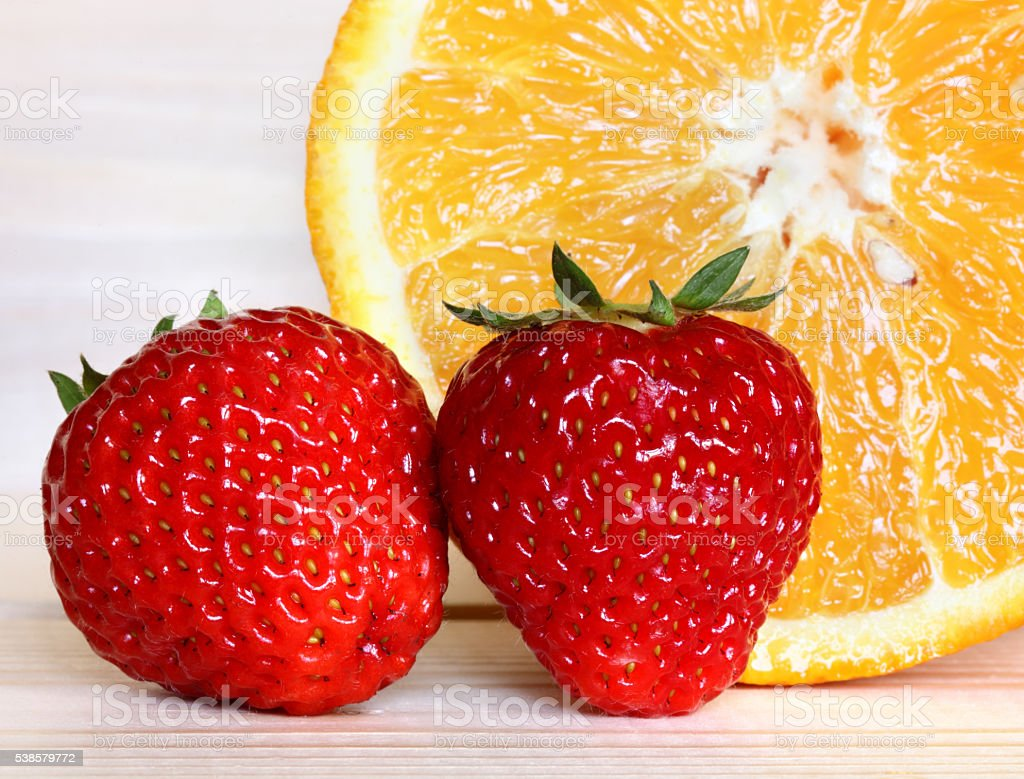 Strawberry and orange stock photo