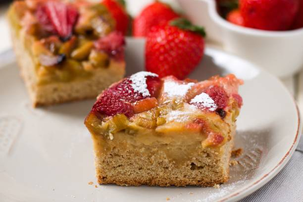 Strawberry and rhubarb cake stock photo