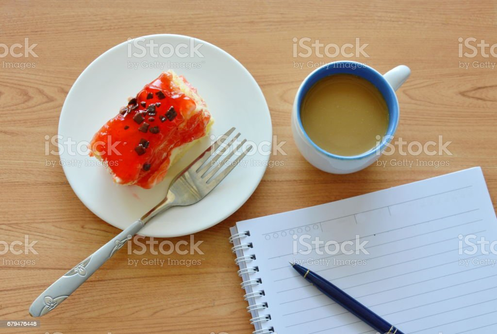 strawberry butter cake and coffee with notebook 免版稅 stock photo