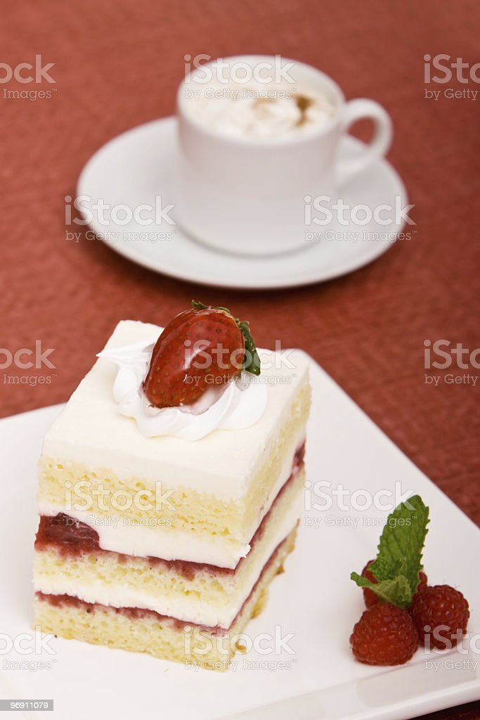 Strawberry cake and cappuccino royalty-free stock photo