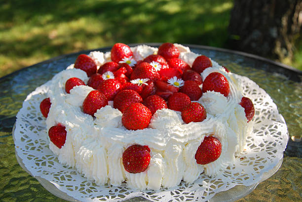 Strawberry cake in a garden stock photo