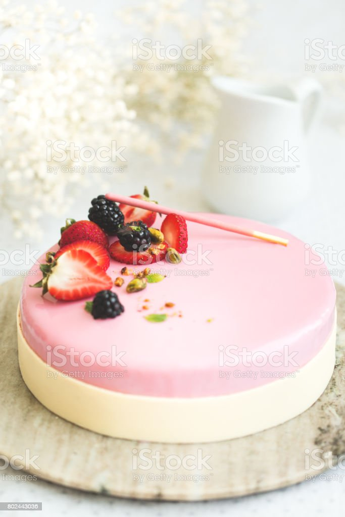 Strawberry cake on a bright background with flowers. stock photo