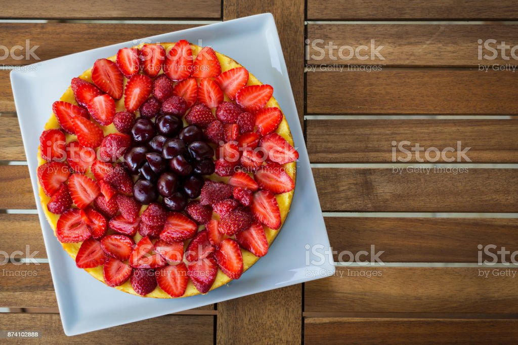 Strawberry cake on a wooden table stock photo