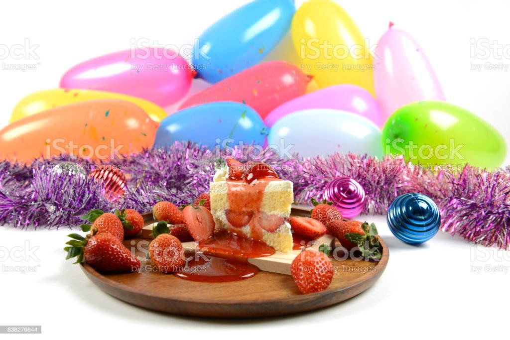 Strawberry cake on party balloons background for celebrations in specials days. stock photo