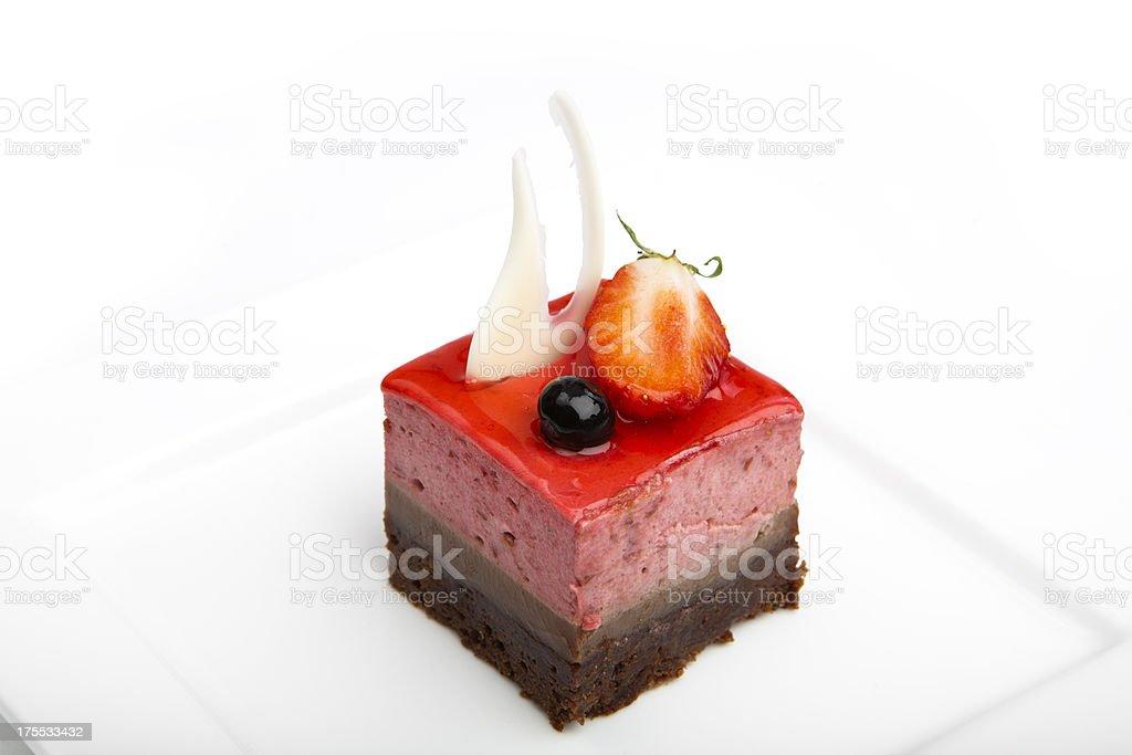 Strawberry cake on white plate stock photo