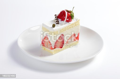 close up of strawberry cake on white table in the morning