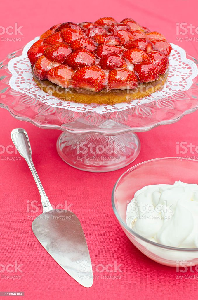 Strawberry cake served with cream royalty-free stock photo
