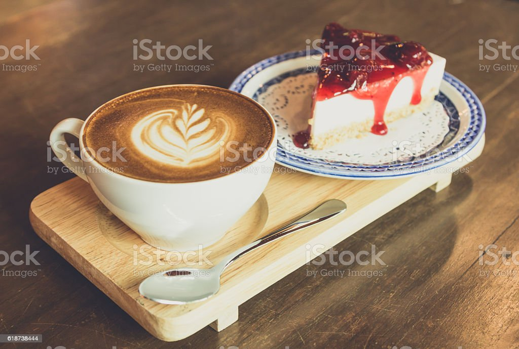 strawberry  cheese cake    and latte coffee  on wood table