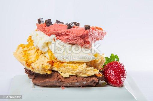 Strawberry, chocolate ice cream on white plate