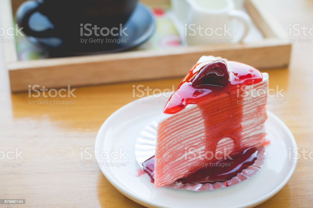 strawberry crape cake in cozy outdoor cafe royalty-free stock photo